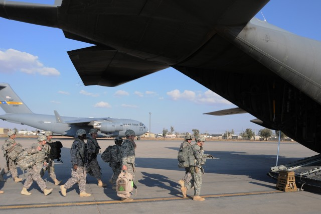 JOINT BASE BALAD, Iraq -- Soldiers from the 2nd Brigade Combat Team (Advise and Assist), 1st Cavalry Division, load an Air Force C-130 to depart Joint Base Balad, Iraq, Nov. 7.  The Soldiers were last from the Black Jack Brigade to fly out of JBB.