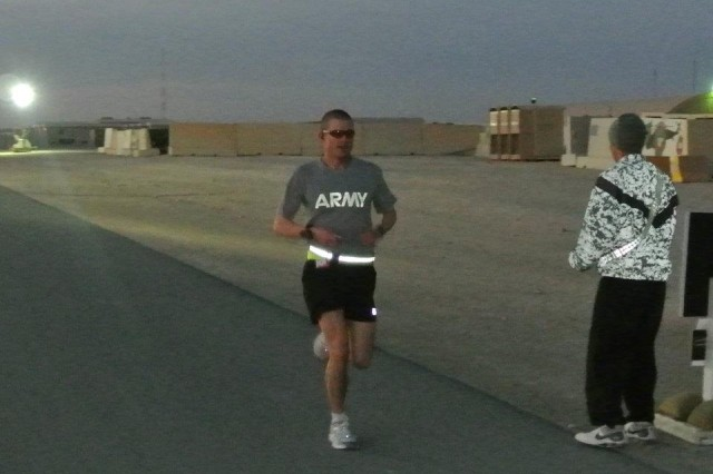 CAMP BUEHRING, Kuwait -- Yorktown, Va. Native Capt. Martin Peters, the commander of Headquarters and Headquarters Company, 2nd Battalion, 5th Cavalry Regiment, 1st Brigade Combat Team, 1st Cavalry Division, runs during the Camp Buehring Marathon, Feb. 12. Peters completed the 26.2-mile marathon in two hours and 58 minutes.