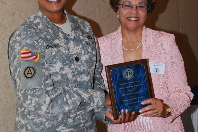 Lt. Col. Martha K. Brooks, ECC public affairs officer, is presented the Military Meritorious Service Award by Mary Peoples, president, North Alabama Chapter of Federally Employed Women.