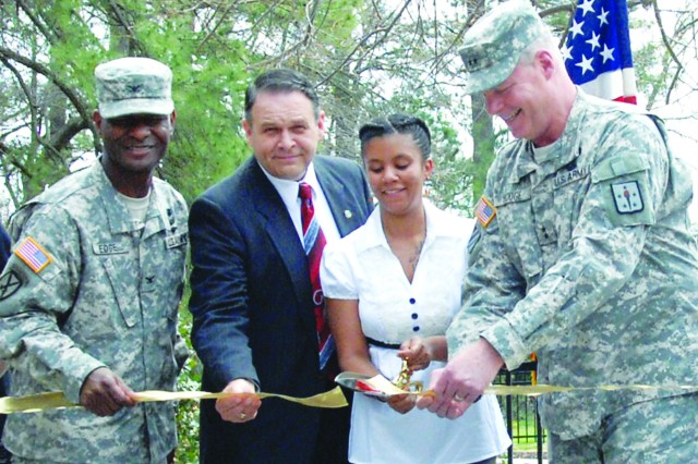 Gold Star Spouse Marion Tate joins Maj. Gen. James L. Hodge, CASCOM and Fort Lee commanding general, right, David D. Tindoll Jr., IMCOM Atlantic Region director, and Col. Rodney D. Edge, U.S. Army Garrison, Fort Lee commander, in the ribbon cutting Friday that officially opened the Survivor Outreach Services Memory Garden along Mahone Avenue.
