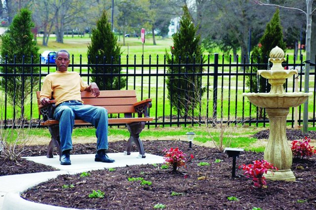 Michael D. Moody Sr., the father of Staff Sgt. Michael  D.  Moody  Jr., who was killed in Iraq June 23, 2007, enjoys a quiet moment in the Survivor Outreach Services Memory Garden Friday, following the ribbon cutting that officially opened the site.