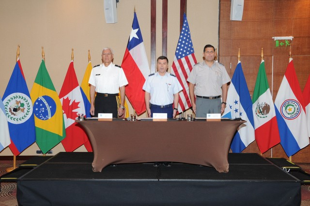 (Left to right) Brig. Gen. Manuel Ortiz, deputy commanding general for U.S. Army South, Gen César Mac-Namara Manriquez, Chilean chief of staff and  Brig. Gen. Leonardo Martinez Menanteau, director of Peacekeeping Operations-Americas for Chile, prepare to sign the memorandum of understanding between U.S. Army South and the Chilean Joint Staff regarding the upcoming multinational exercise, Peacekeeping Operations-Americas. PKO-A 2012 provides valuable experiences for members of the United States military to learn from NGOs and the civilian and military experts from the 17 participating nations. This experience helps ensure the U.S. military is able to rapidly respond in support of emergency relief efforts.  (U.S. Army photo by Miguel Negron, U.S. Army South Visual Information)