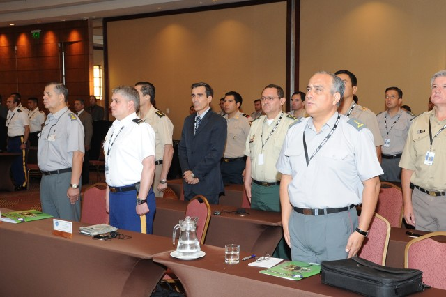 "Participants of the final planning conference for the upcoming multinational exercise, Peacekeeping Operations "" Americas, stand at attention prior to the signing of the memorandum of understanding between U.S. Army South and the Chilean Joint Staff. PKO-A 2012 provides valuable experiences for members of the U. S. military to learn from NGOs and the civilian and military experts from the 17 participating nations. This experience helps ensure the U.S. military is able to rapidly respond in support of emergency relief efforts.  (U.S. Army photo by Miguel Negron, U.S. Army South Visual Information)"