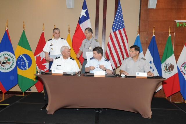 (At the table, left to right) Brig. Gen. Manuel Ortiz, deputy commanding general for U.S. Army South, Gen. César Mac-Namara Manriquez, Chilean chief of staff and  Brig. Gen. Leonardo Martinez Menanteau, director of Peacekeeping Operations-Americas for Chile, sign the memorandum of understanding between U.S. Army South and the Chilean Joint Staff regarding the upcoming multi-national exercise, Peacekeeping Operations-Americas. Peacekeeping Operations-Americas 2012 is a series of multinational exercises designed to enhance regional dialogue among military forces from 17 countries, governmental, non-governmental agencies and inter-governmental organizations in order to address concerns, lessons learned and new initiatives involved in peacekeeping.  (U.S. Army photo by Miguel Negron, U.S. Army South Visual Information)