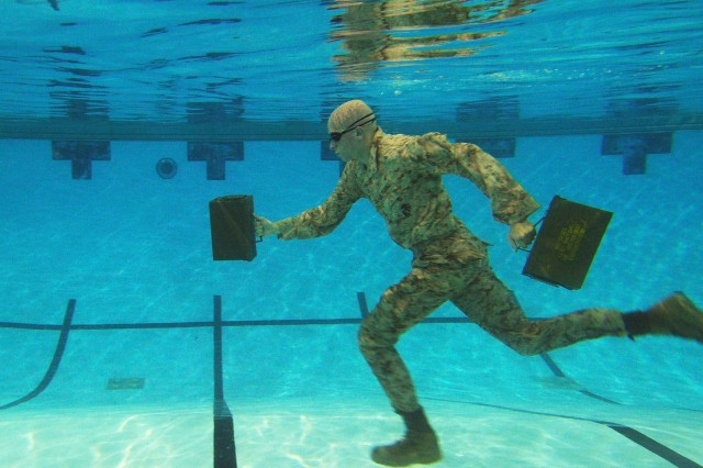 SPORTS 2ND PLACE: U.S. Marine Corps Lance Cpl. Reagan Lodge, Headquarters and Service Battalion, Marine Corps Base Quantico, conducts water running exercises during a physical training session in Ramer Hall, The Basic School, on Marine Corps Base Quantico, Va., Sept. 14, 2011.