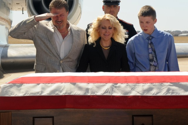 NEWS 1ST PLACE: A father salutes the casket of his son on March 31, 2011, at Buckley Air Force Base, Colo., honoring Lance Cpl. Christopher Mies when he arrived home.
