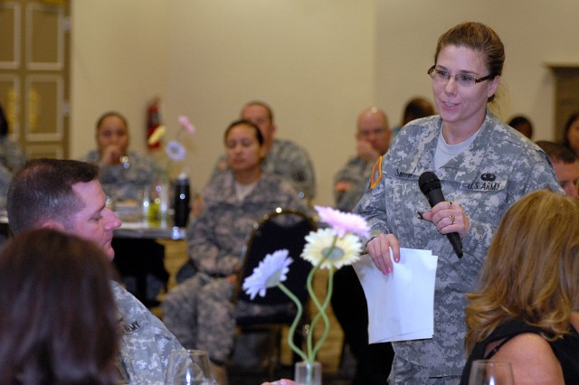 Guest speaker Col. Alicia Smith, faculty at the Industrial College of the Armed Forces, talks about how women used to have to choose career or family during the Women's History Month luncheon March 16 at the Frontier Conference Center., Fort Leavenworth, Kan.