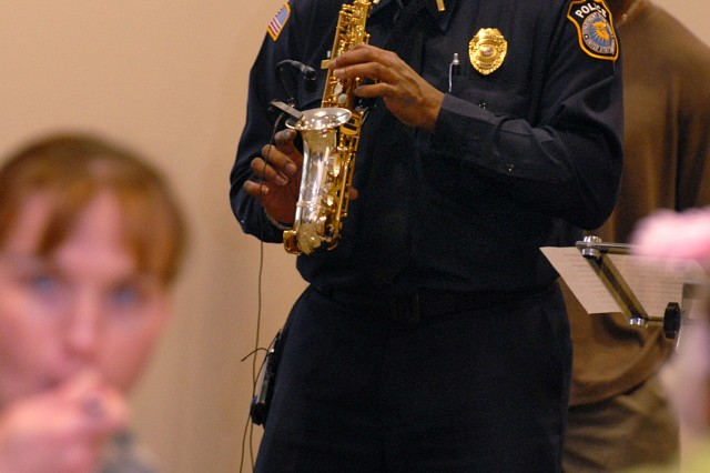 Department of the Army Police Lt. Melvin Lister performs at the Women's History Month luncheon March 16 at the Frontier Conference Center. Lister and Ron Coaxum on saxophones and Rob Perry on trumpet performed jazz pieces as luncheon attendees began their meal at Fort Leavenworth, Kan.