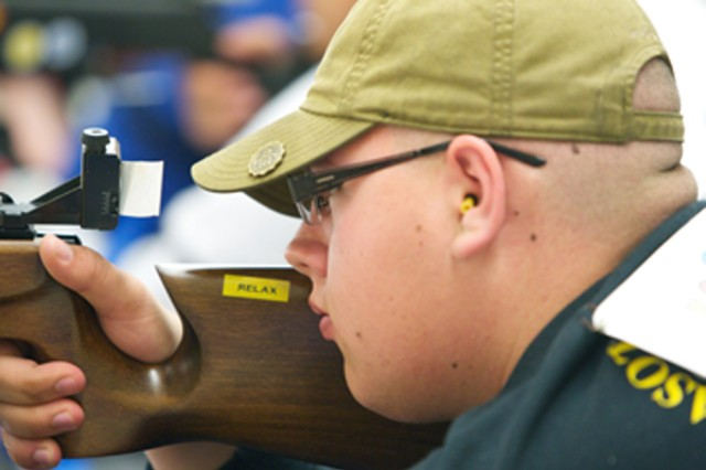 Robin Chastain, of Sarasota Military Academy, takes aim at a target during Thursday's practice round at the Civilian Marksmanship Program's indoor range in Anniston, Ala.