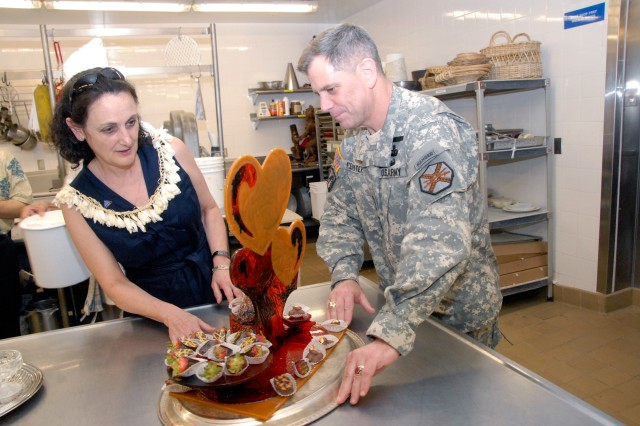 Lt. Gen. Michael Ferriter and his wife, Margie, admire a table decoration made of pulled sugar at the Hale Koa Hotel at Fort DeRussy. The Ferriters toured the Armed Forces Recreation Center, Tuesday.