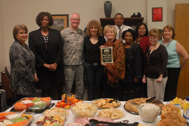 Brig. Gen. Douglas R. Satterfield, deputy commander of 412th Theater Engineer Command, wife Nancy, Sonia Wriglesworth, director of USARC Family Programs, Brenda McWilliams, director of 412th TEC Family Programs, and staff during a luncheon for the visiting team Mar. 20, 2012, Vicksburg, Miss. Satterfield invited Wriglesworth to assist the TEC Family Programs team in developing, implementing, and evaluating effective measures necessary to support the command's 13,000 Soldiers and their family members. (Photo: Capt. Maryjane Falefa Porter, 412th TEC Public Affairs)