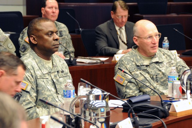 Gen. Lloyd J. Austin III (left), Army vice chief of staff, and Gen. Robert W. Cone, commanding general of U.S. Army Training and Doctrine Command listen to updates on TRADOC initiatives during Austin's visit to TRADOC's new headquarters at Fort Eustis, Va., March 22, 2012.