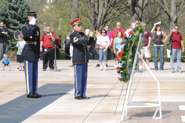 A bugler from The United States Army Band (Pershing's Own) plays Taps during a wreath laying ceremony at the Tomb of the Unknown Soldier, Arlington National Cemetery, Va., Mar. 23, 2012.  The wreath was laid to mark National Medal of Honor Day.  National Medal of Honor Day is observed yearly on March 25.  On March 25, 1863 six U.S. service members became the first service members to be presented the Medal of Honor. (U.S. Army photo by Spc. Devin Kornaus)