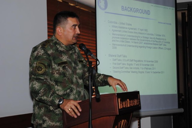 """BOGOTA, Colombia """" Col. German Lopez, Colombian Foreign Liaison Officer at Army South, explains the background of the U.S. and Colombian military partnership and the bi-lateral staff talks at the start of this year's talks March 21.  (Photo by Col. Jane Crichton, Army South Public Affairs)"""