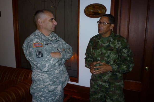 """BOGOTA, Colombia """" Lt. Col. Luis Rodriguez, Army South staff judge advocate, talks with Colombian army Command Sgt. Maj. Jorge Mercado during a break in the third annual U.S. and Colombian army bi-lateral staff talks March 21.  (Photo by Col. Jane Crichton, Army South Public Affairs)"""