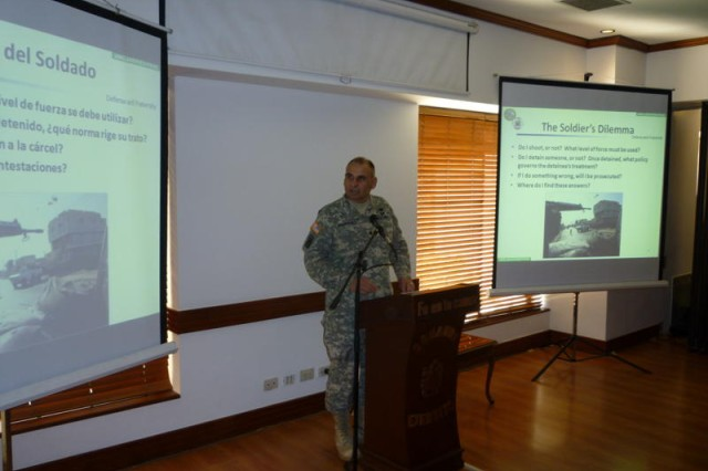 """BOGOTA, Colombia """" Lt. Col. Luis Rodriguez, Army South staff judge advocate, briefs the intricacies of military operational law during the third annual U.S. and Colombian army bi-lateral staff talks March 21.  (Photo by Col. Jane Crichton, Army South Public Affairs)"""