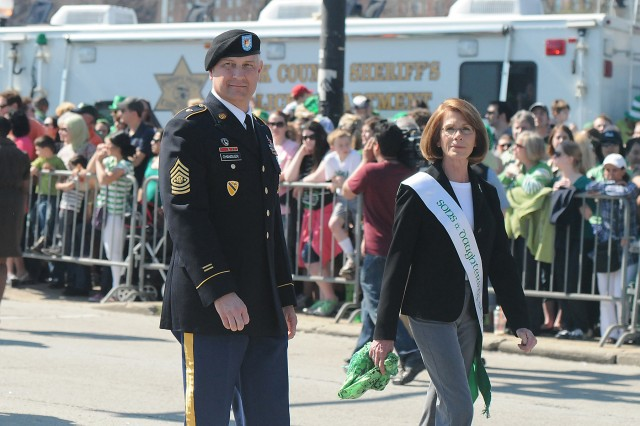 Sgt. Maj. of the Army Raymond F. Chandler III participates with his wife Jeanne, as the co-grand marshal of the Chicago St. Patrick's Day parade, March 17, 2012. Chandler was in Chicago on March 16, and 17 to meet with industry leaders and businesses to discuss opportunities for Veterans and the potential opportunities in hiring Veterans.  Chandler also met with local Chicago recruiters at the 47th street recruiting station to share information on what potential changes are taking place in the Army, and to gain feedback from the Soldiers on issues they face.