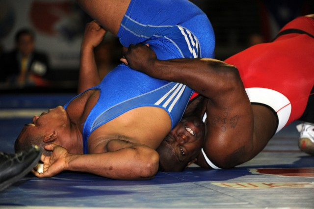 U.S. Army World Class Athlete Program Greco-Roman wrestler Sgt. 1st Class Dremiel Byers (right) turns Ramon Garcia of the Dominican Republic en route to a 2-0, 1-0, victory in the semifinals of the 120-kilogram/264.5-pound division of the 2012 FILA Pan American Olympic Games Qualifying Tournament on April 24, 2012, at Silver Spurs Arena in Kissimmee, Fla. Byers won the gold medal and qualified the weight class for Team USA for the 2012 Olympic Games in London.