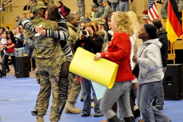 Soldiers with 170th Infantry Brigade Combat Team reunite with their families after returning Feb. 15, 2012, to Baumholder, Germany, from a yearlong deployment to Afghanistan. The unit is scheduled for inactivation this October.