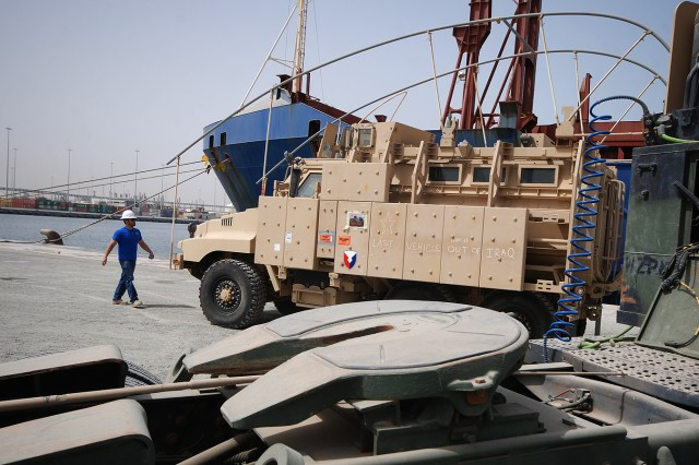 The last mine-resistant, ambush-protected vehicle to depart Iraq is lifted aboard the freighter Ocean Crescent at the Port of Ash Shuaiba, Kuwait, March 24, 2012, for transport to the United States, where it will be preserved and displayed at the 1st Cavalry Brigade Division Museum at Fort Hood, Texas.