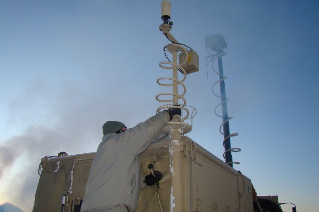 An operator wearing the Army-issued Extended Cold Weather Clothing Systems works with a Warfighter Information Network-Tactical, or WIN-T, Increment 2 Tactical Communications Node, Jan. 13, 2012, during the two-week WIN-T Increment 2 Cold Weather Natural Environments Testing at Fort Greely, Alaska.