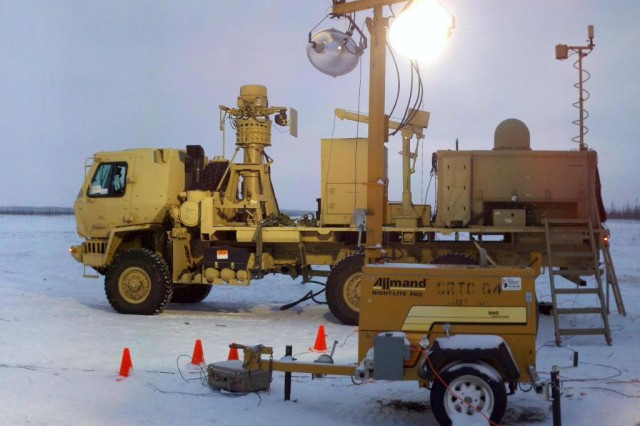 A Warfighter Information Network-Tactical, or WIN-T, Increment 2 Tactical Communications Node being tested beneath the dim Alaskan sky, Jan. 13, 2012, during the two-week WIN-T Increment 2 Cold Weather Natural Environments Testing at Fort Greely, Alaska.