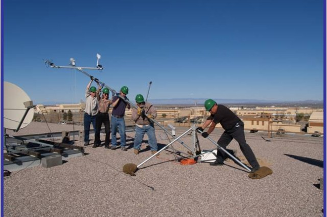 Army Research Laboratory personnel erect a weather monitoring tower on top of the Army Research Laboratory building on White Sands Missile Range, N.M.  The Local-Rapid Evaluation of Atmospheric Conditions system currently uses transportable towers like these, but it's hoped that more mobile versions can be integrated as well.