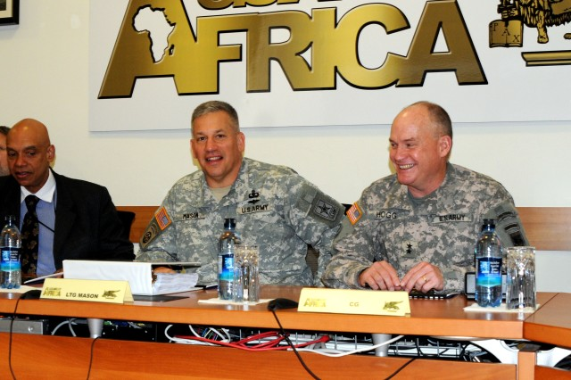 Lt. Gen. Raymond V. Mason receives a command brief from U.S. Army Africa Commander Maj. Gen. David R. Hogg and his staff. Mason is the U.S. Army's deputy chief of staff for logistics, G-4. USARAF was one of several Army units Mason toured during a recent visit to Europe.