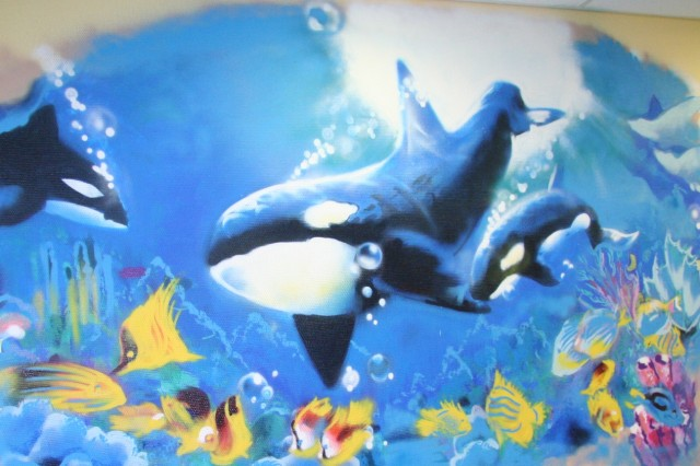 Granados' underwater mural mixes graffiti style with contemporary art.