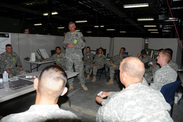 Lt. Col. Matthew Fath, commander of the 1/35 Armor, 2nd Brigade Combat Team, 1st Armored Division, conducts an after-action review with Soldiers from A Company, 1/35 Armor, and B Company, 86th Expeditionary Signal Battalion.