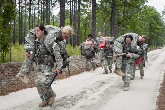 Soldiers perform tasks in order to showcase their determination and physical endurance during the Cultural Support Assessment and Selection program at Fort Bragg, N.C. Female Soldiers who are selected to attend the Cultural Support training course are taught to support special-operations units in deployed environments.