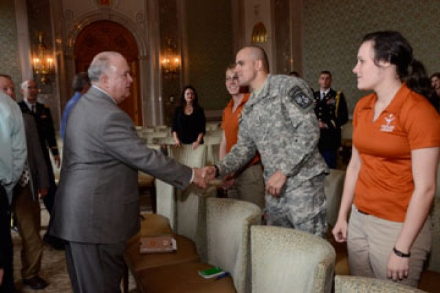 Undersecretary of the United States Army Joseph W. Westphal greets Global Policy Studies graduate student Noah Koubenec during a group discussion with other Texas Army ROTC cadets and Senior Service College Fellows.