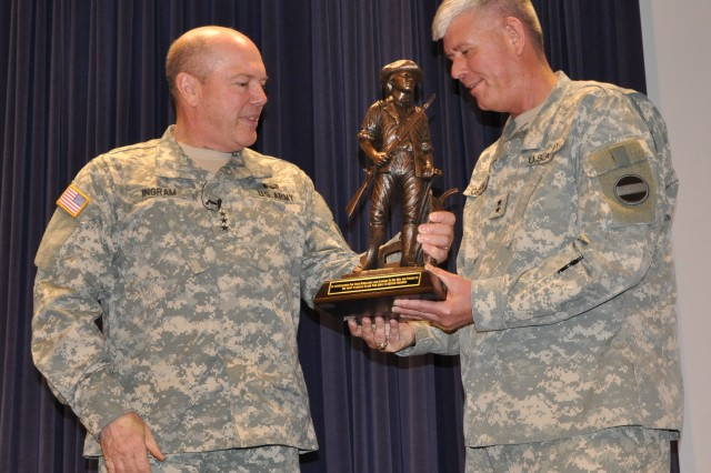CAMP ROBINSON, ARKANSAS (March 26, 2012)  Lt. Gen. William E. Ingram Jr. (left), director of the Army National Guard, presents a statue of a Minuteman, symbol of the National Guard, to Maj. Gen. Mark Graham, FORSCOM deputy chief of staff for G-3/5/7, in appreciation of the unstinting support he has given the National Guard. Graham will retire in May.