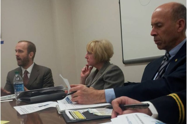 Mr. Jeffrey Little, HUD (left), Ms. Kathy Callahan, OBT (middle), and Mr. Roger Harold, OBT (right) attend a collaborative session between Army and HUD staffers.