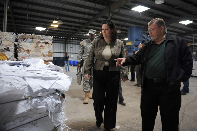 Katherine Hammack, assistant secretary of the Army for Installations Energy and Environment, toured Fort Hood facilities, Nov. 29 to Dec. 1, 2011, on the installation dedicated to the Army's Net Zero program. Fort Hood is a pilot program for the Net Zero Waste program and aims to achieve zero waste on the installation by 2020 through recycling, reuse and reducing consumption. During her visit, she toured the post's recycling facility, a solar carport, refurbished barracks, a dining facility where solar water panels are used to heat water and a waste water pump.