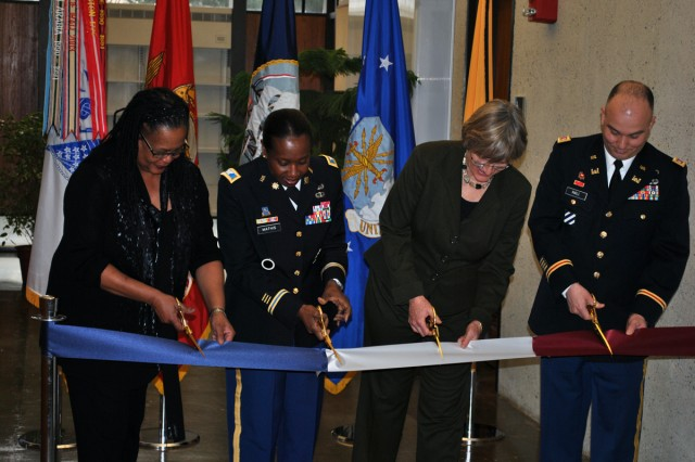 Harvard Dean Evelynn Hammonds, Col. Twala Mathis, President Drew Faust and Lt. Col. Tim Hall cut the ribbon Wednesday to commemorate the U.S. Army ROTC return to Harvard University. Harvard was one of the first Army ROTC units established in 1916, and the event formally recognized the Army's first official presence on campus since 1976.