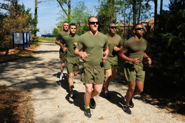 A group of Marines run on the Engineer Trail Monday.