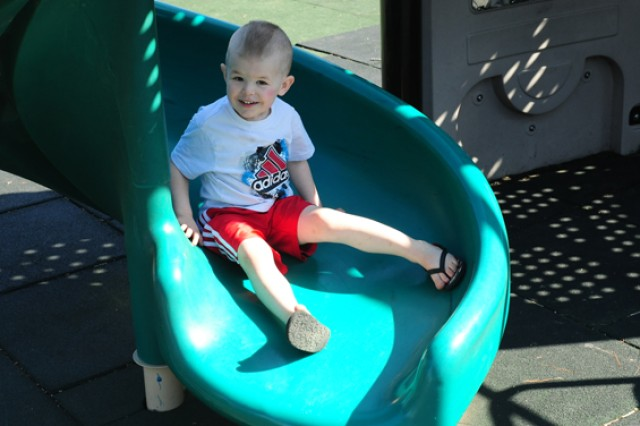Justin Rogers, 3, tries out a slide at Colyer Park. Both Engineer Trail and Colyer Park have been recently upgraded and improved to better meet the needs of service members and families.