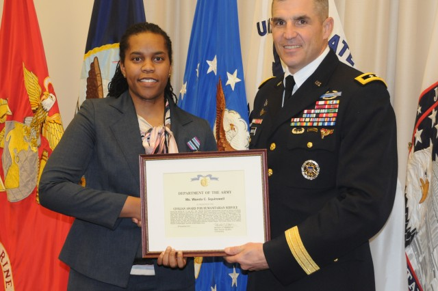 The Civilian Award for Humanitarian Service was presented to Dept. of the Army employee Wanda C. Squirewell for courageous actions taken to save the life of another woman in Arlington, Va. July 2, 2011. Squirewell heard screaming coming from a bridge railing, ran towards the screams to investigate, and found a woman hanging by her hands. Not thinking of her personal safety, Squirewell hung over the railing to stabilize the suspended woman and waited for help to arrive. She was presented the award by Maj. Gen. Michael S. Linnington, commanding general of the Joint Force Headquarters-National Capital Region and the U.S. Army Military District of Washington at a ceremony held at Fort McNair, March 20, 2012.