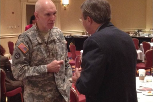LTG Bill Grisoli speaks with a conference attendee.