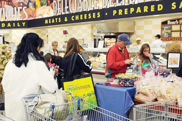 Shoppers sample foods near the bakery and deli March 13 following the ribbon-cutting ceremony for the Fort Riley Commissary.
