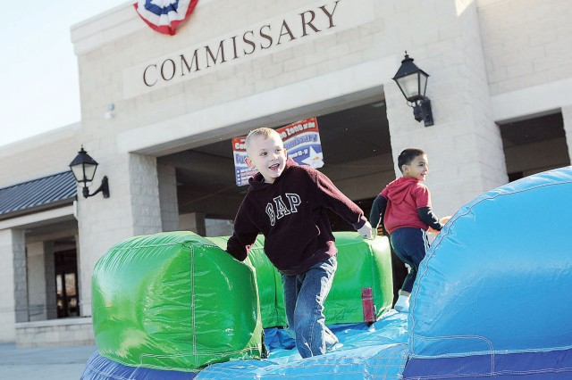 Sean Kopecky, 5, plays on an inflatable March 13 outside of the Fort Riley Commissary during its reopening celebration.