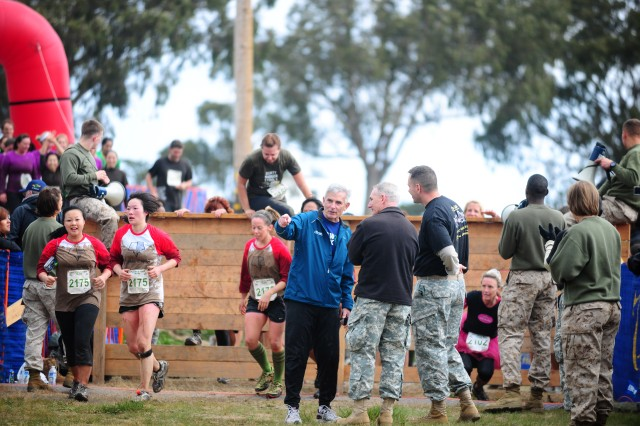 PRESIDIO OF MONTEREY, Calif. - Race director and retired Marine, Wally Kastner speaks with 229th Military Intelligence Battalion Commander Lt. Col. Kent Webber near the final mud pit during the 2012 Big Sur Mud Run.