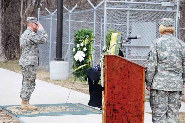 A Soldier with the 97th MP Bn. pays his respects to Sgt. 1st Class Hary during his memorial ceremony March 15 at the K9 section's kennels, Fort Riley, Kan. The military working dog was laid to rest Feb. 1 after a life of service to Fort Riley and the surrounding communities.