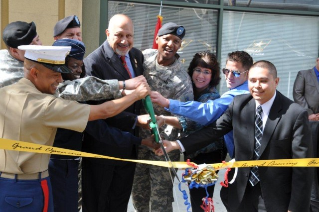LOS ANGELES - Dignitaries and armed forces representatives cut a ceremonial ribbon during the grand opening of L.A. Career Center March 28 in downtown Los Angeles, Calif. The U.S. Army Corps of Engineers Los Angeles District will manage the lease of the 50,000 square-foot recruitment center for future soldiers, airmen and marines.