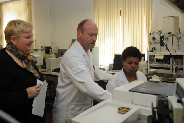 Heidi Bodeit (left), the director of the Army Oil Analysis Program Laboratory Center in Mannheim, Germany, Detlef Nuss (middle) and Dahab Gebreyohammes, who are physical science technicians for AOAP, work with one of the many testing systems at the laboratory March 26. The AOAP processes more than 400 samples of oil from military equipment each month and can have the results back to the unit within 24 hours for air equipment and 72 hours for ground equipment.