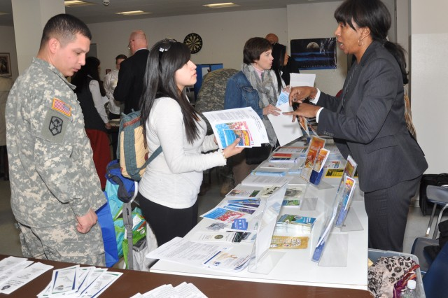 Marlene Balzer (right) of the U.S. Army Garrison Wiesbaden's Marketing Office tells 1st Battalion, 214th Aviation Regiment, Soldiers and Families about FMWR opportunities in Wiesbaden.