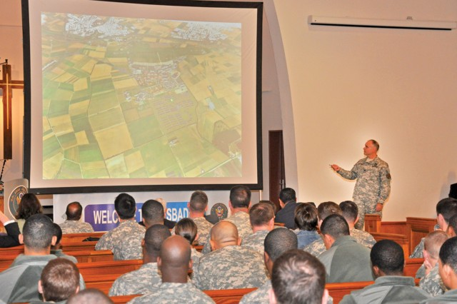 Col. David Carstens, U.S. Army Garrison Wiesbaden commander gives members of the 1st Battalion, 214th Aviation Regiment, a virtual tour of the Wiesbaden military community during a Town Hall in Mannheim.