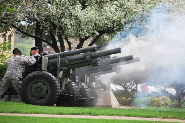 Army Sustainment Command Soldiers fire 11-cannon volleys in honor of Brig. Gen. Brian R. Layer, ASC deputy commanding  general for Sustainment, who deferred it to all retirees and veterans, during the March 29 Retirement and Retreat ceremony held at Rock Island Arsenal, Ill.