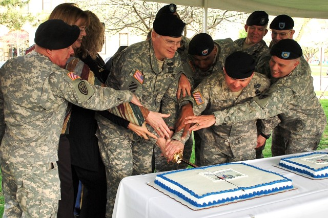 Brig. Gen. Brian R. Layer, Army Sustainment Command deputy commanding  general  for Sustainment, along with ASC Command Sgt. Maj. James Spencer, lead retirees in an after-ceremony cake cutting.  Two cakes were available for all retirees and attendees.